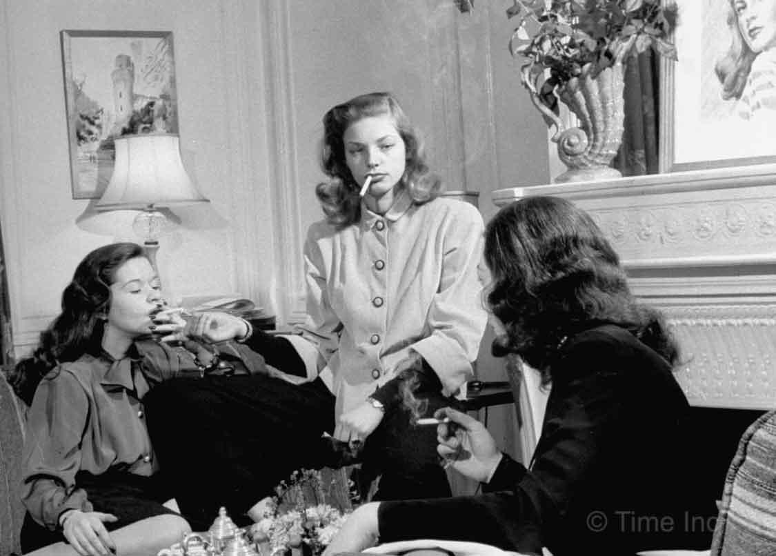 Lauren-Bacall-smokes-with-pals-1945-Nina-Leen
